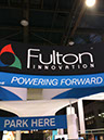 Fulton Electrical Booth Charging a Tesla at CES 2011